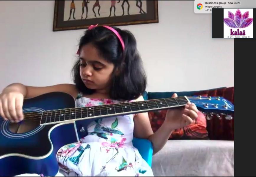 Girl learning guitar at Kalaa